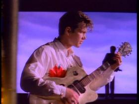 Chris Isaak You Owe Me Some Kind Of Love